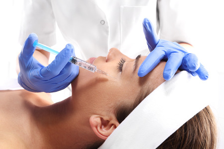 toxin: Portrait of a white woman during surgery filling facial wrinkles, Cosmetic is injected into facial skin cosmetics