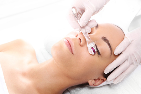 Rejuvenation, beautification, the woman at the beautician, Mesotherapy microneedle