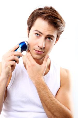 electric razor: Young, attractive boy electric razor stubble goals Stock Photo
