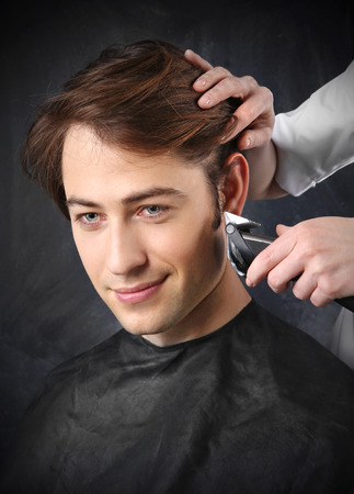 sideburns: Portrait of a young white boy while cutting hair in the hair salon