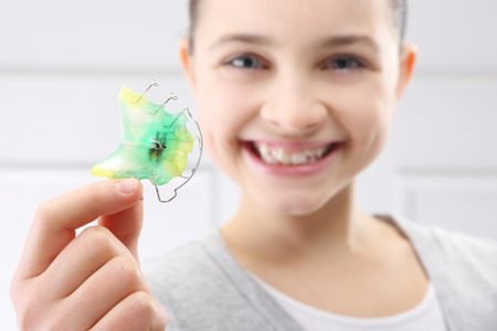 orthodontist: Child with orthodontic appliance