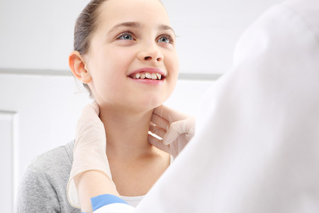 The girl in the office of a pediatrician, medical examination photo