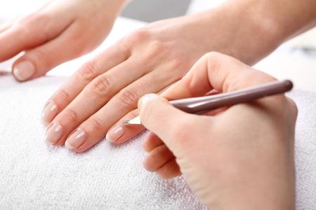 beautician: Manicure, cutting skins woman to a beautician