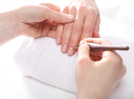 nail file: Manicure, cutting skins woman to a beautician