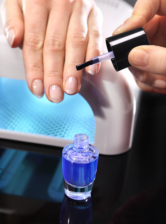 nail bar: Curing nail, manicure hybrid, nail polish Stock Photo