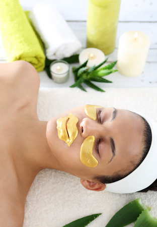 collagen: Gold mask, skin care around the eyes and mouth, Stock Photo