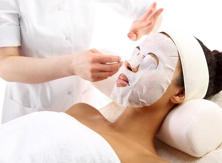 black mask: Cleansing facial skin, a woman in beauty salon Stock Photo