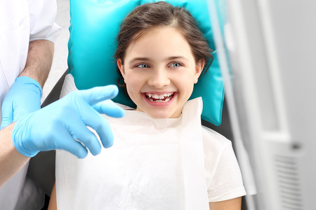 Dentistry, joyful child in the dental chair photo