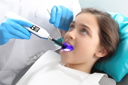 scaling: Treatment of tooth loss, the child to the dentist Stock Photo