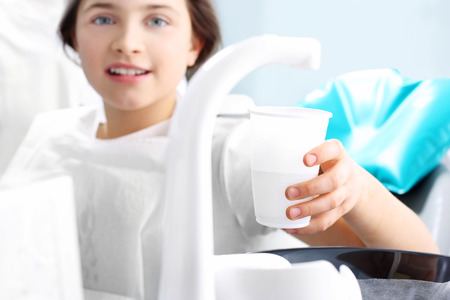 scaling: Dentist, child in the dental chair.