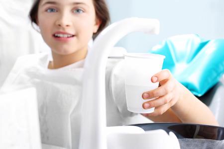 dental chair: Dentist, child in the dental chair.