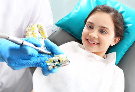 Treatment of the tooth, the dentist cleans loss photo