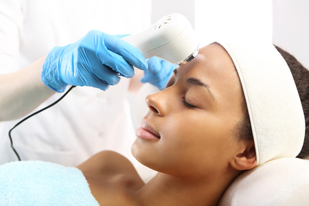 Ultrasound infrared light cosmetic treatment for the face  photo