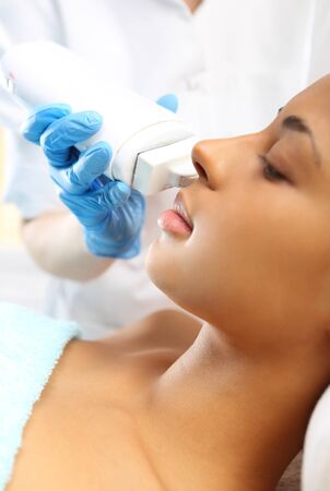 skin scrub: The womans face during a facial at a beauty salon Stock Photo
