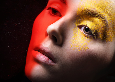 characterization: Fiery eye makeup - energy and passion.Portrait, close-up on the face of a woman in a fancy makeup.