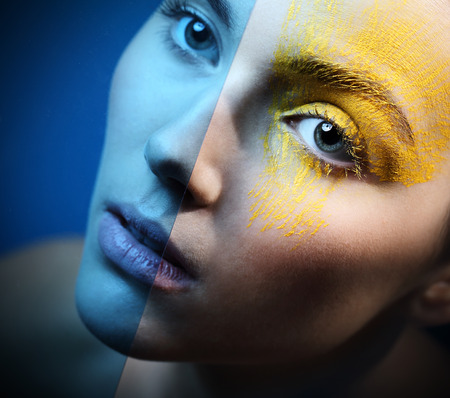 characterization: Blue eye makeup ice - cold sensual.Portrait, close-up on the face of a woman in a fancy makeup. Stock Photo