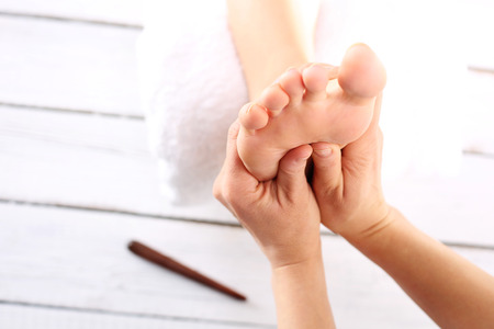 Map feet, reflexology. Natural medicine, reflexology, acupressure foot massager oppresses energy flow points