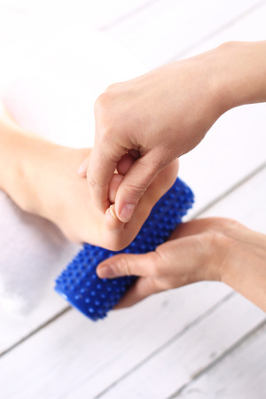 massaged: Foot Massage and physiotherapy.Female foot massage device massaged. Stock Photo
