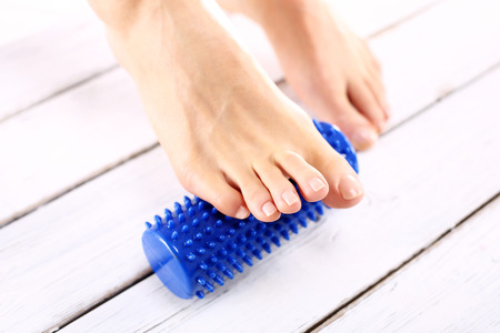 massager: Rehabilitation foot massage,Female foot massage device massaged. Stock Photo