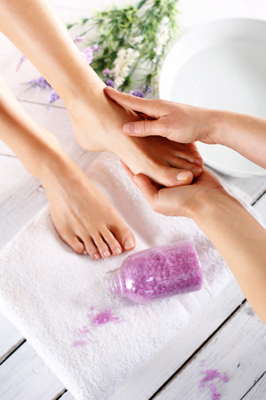 hands massage: Foot massage Stock Photo