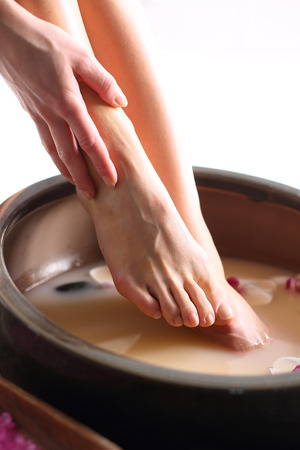 foot cream: Therapeutic foot bath Stock Photo