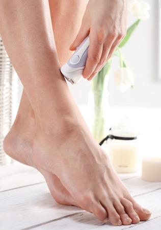 electric razor: Beautiful female legs shaved smooth