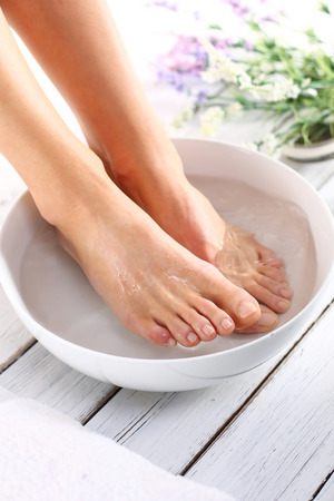 woman in bath: Therapeutic foot bath Stock Photo