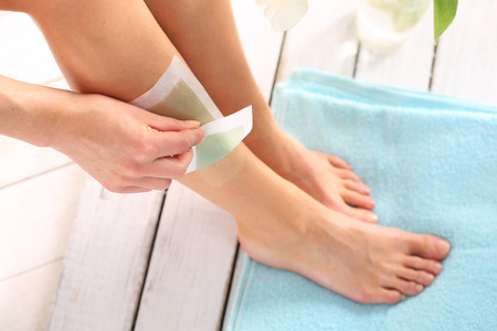 Hair.Removal leg wax. Female depilated legs slice of wax