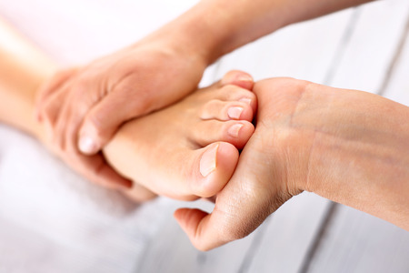 foot pain: Rehabilitation foot massage Stock Photo