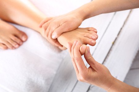 acupressure hands: Reflexology Stock Photo