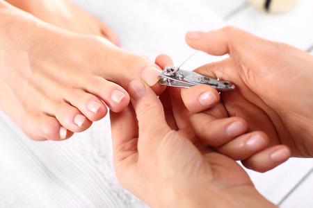 pedicura: Recorte las uñas, mujer de pedicura