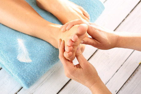 pressure massage: Reflexology Stock Photo