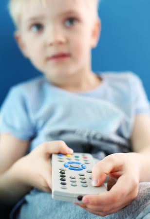 looker: I love television. A child with a TV remote control