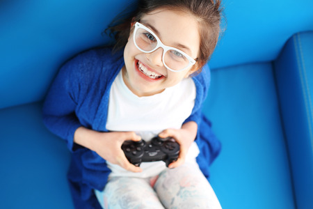 playing video game: I love to play! Child playing video game