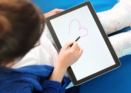 first love: First love, girl draws a heart