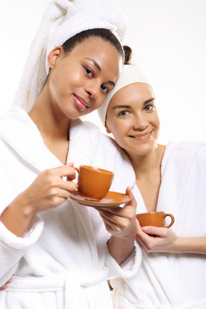 beauty store: Two women in wellness salon dressed in white robes Stock Photo