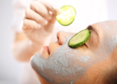 Cosmetic moisturizing mask is applied to the face of a woman. Stock fotó