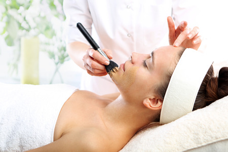 beautiful neck: Cosmetic moisturizing mask is applied to the face of a woman Stock Photo