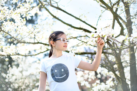 Summer sunny day relaxing in the countryside. A child jumps high in the spring morning Print on Tshirt own g photo