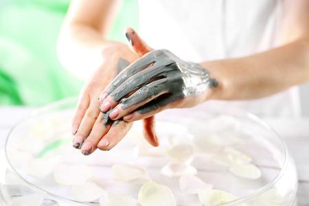 clays: Beautiful female hands cosmetic procedure