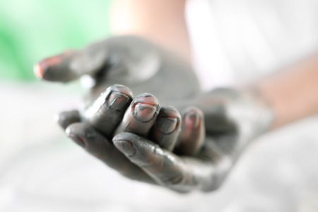 mud woman: Manicured hands in the summer .Women39s hands during surgery cosmetic hands with the applied mask with green clay. Stock Photo