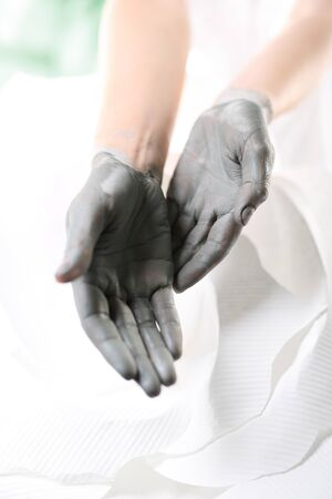 Home spa for hands. Women39s hands during surgery cosmetic hands with the applied mask with green clay. photo