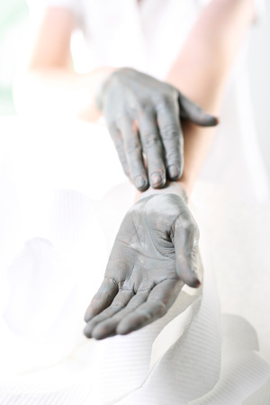 Mask for hands.Women39s hands during surgery cosmetic hands with the applied mask with green clay. photo