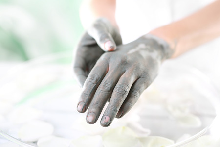 acupressure hands: Acupressure natural hand massage.Women39s hands during surgery cosmetic hands with the applied mask with green clay. Stock Photo
