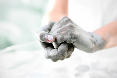 Beauty salon mask for hands.Women39s hands during surgery cosmetic hands with the applied mask with green clay. photo