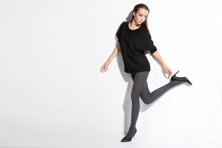 shapely legs: Beautiful, leggy woman in thin tights and fashionable styling Stock Photo