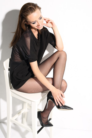 shapely legs: A beautiful woman sitting on a chair
