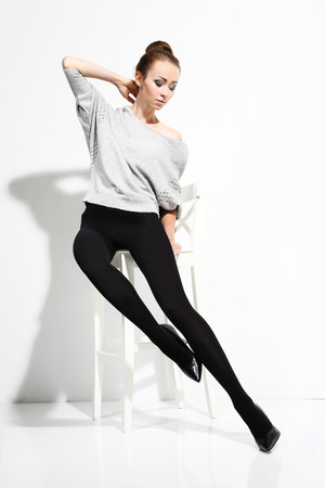 Beautiful woman in tights. Imagens