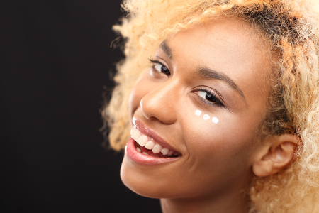 young black girl: Well groomed facial skin