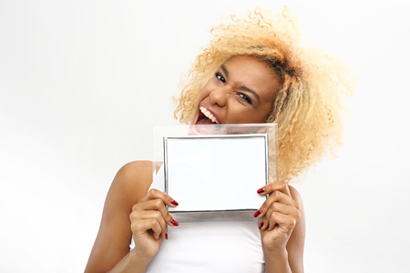 for text: A young woman holds in her hands the frame with space for text